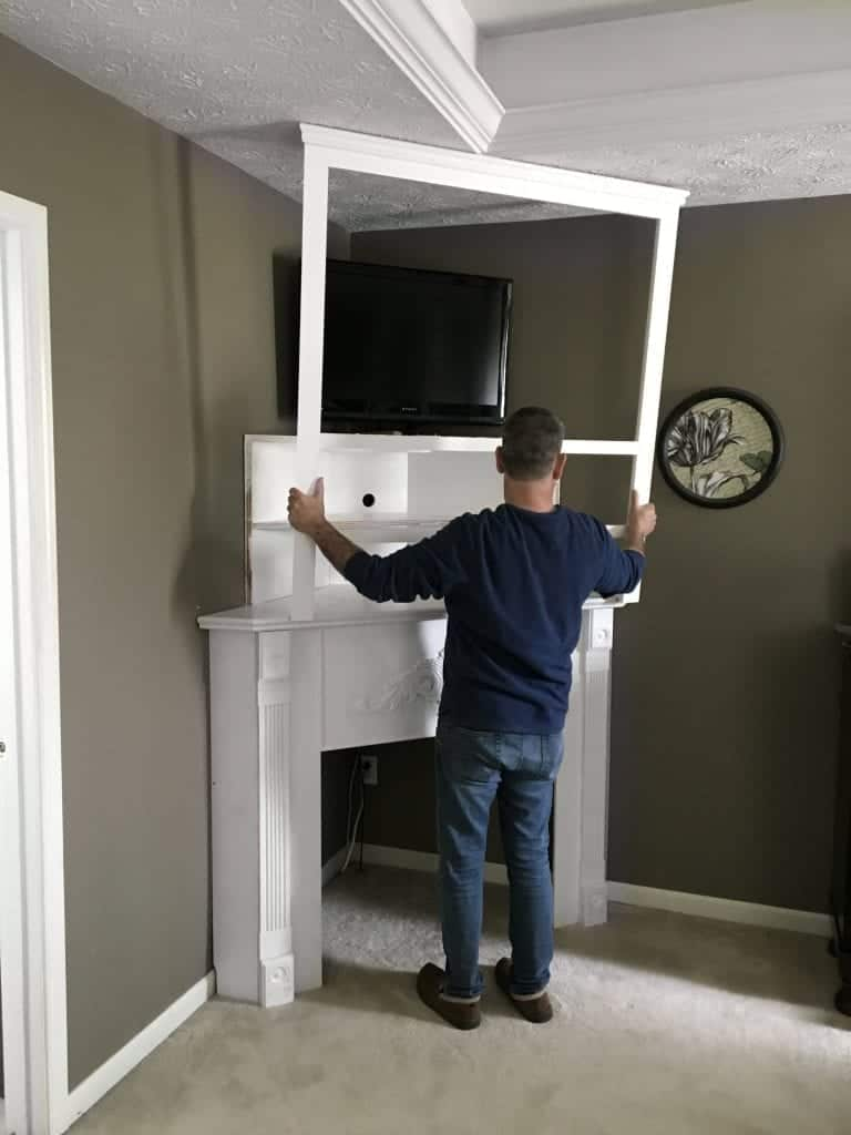 DIY Corner Fireplace Mantel framing it in